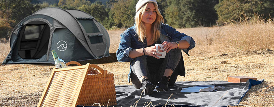 girl drinking coffee while camping