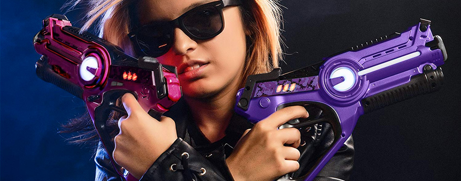 girl holding laser tag set