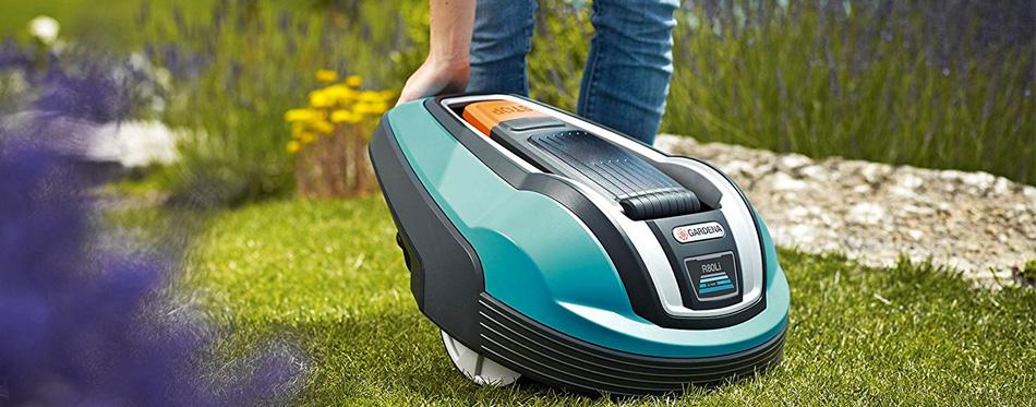 man using robot lawn mower