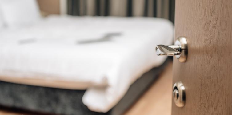 hotel door and bed