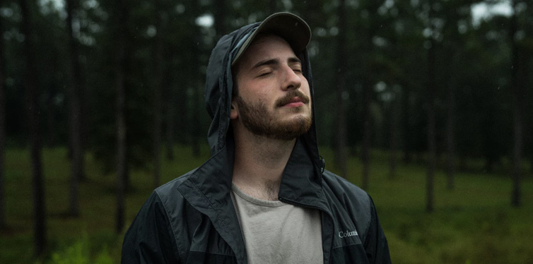 man with his eyes closed in the nature