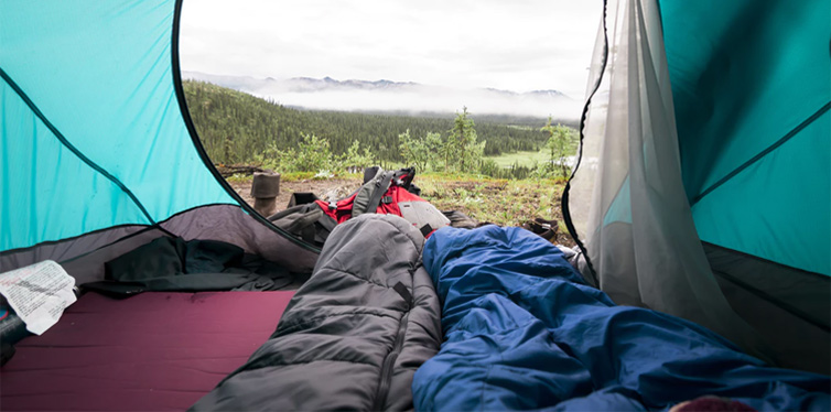view from a tent and sleeping bags