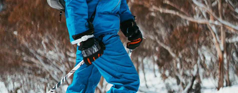 man wearing ski gloves