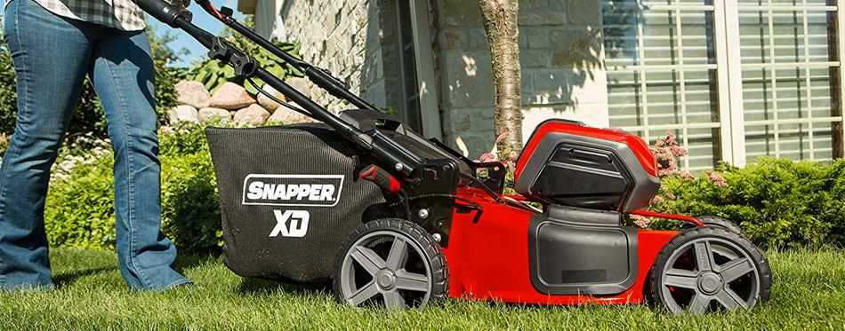 woman using cordless lawn mower