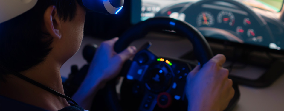 man using racing wheel