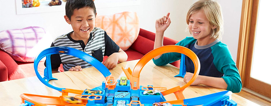 boys playing with hot wheels track