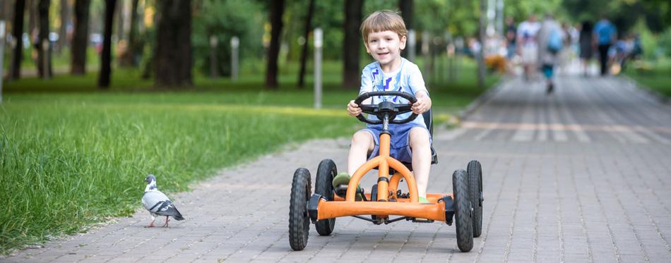 boy having fun while using go-kart