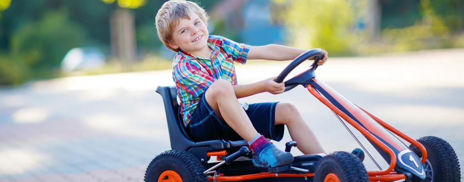 boy riding go-kart