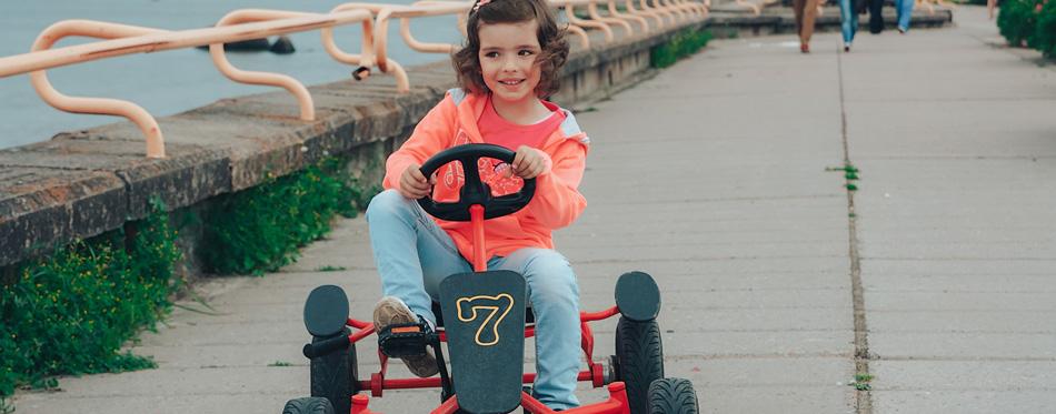 girl riding go-kart