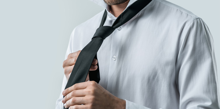 man making his tie knot