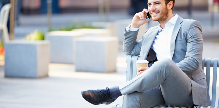 man on the phone wearing fitted pants