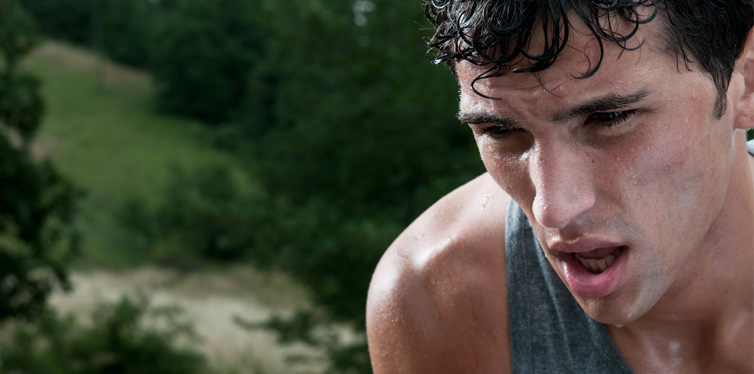 man sweating after running