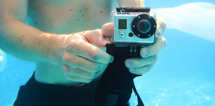 man taking photo underwater