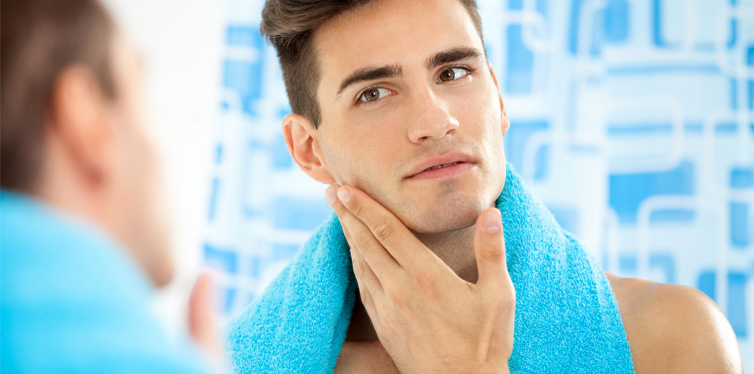 man touching his face after shave