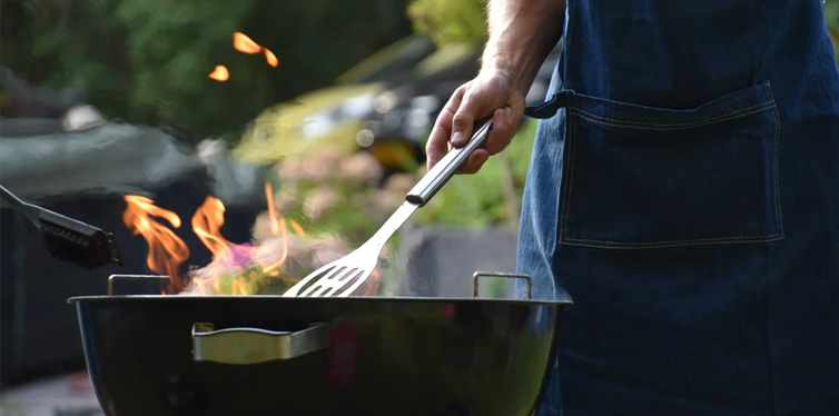 man using grill