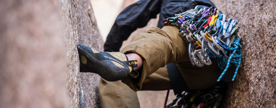 man wearing climbing shoes
