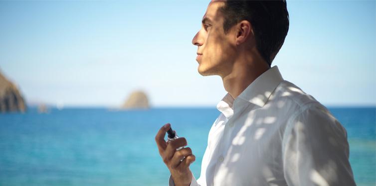man holding a perfume