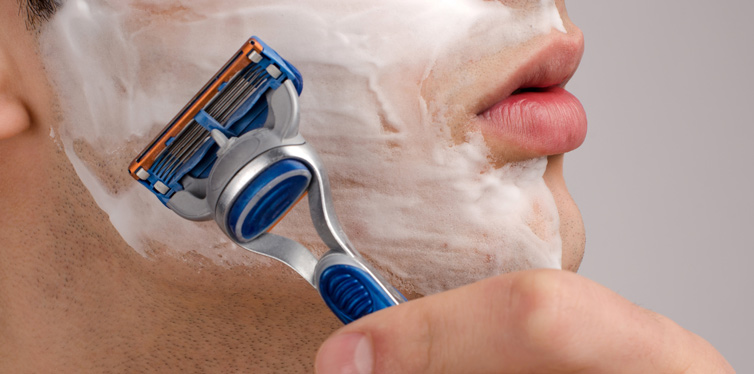man shaving with the razor