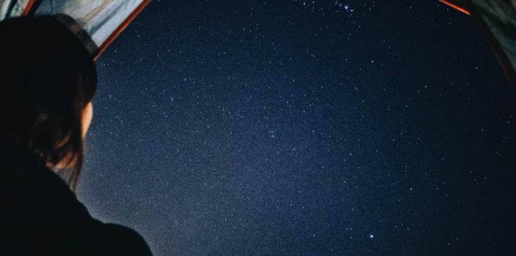 a person stargazing