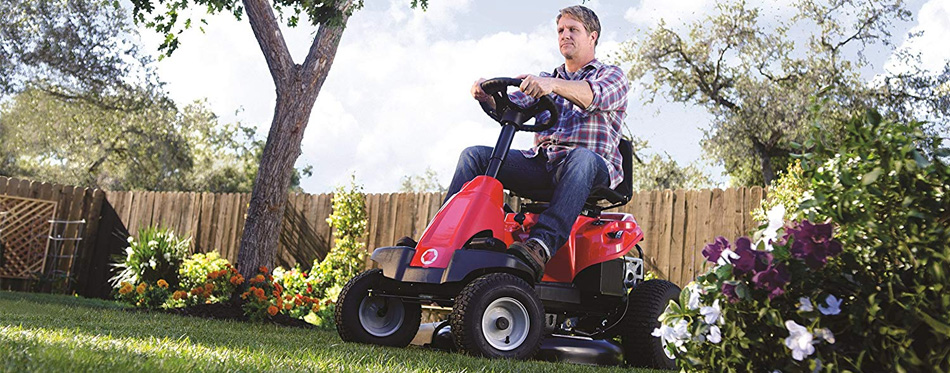 man using lawn mowers