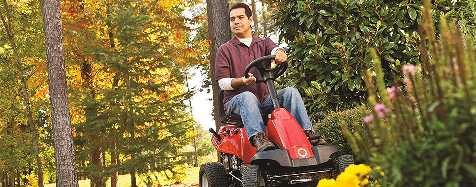 man driving lawn mower