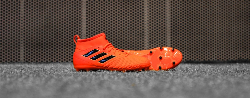 orange soccer cleats