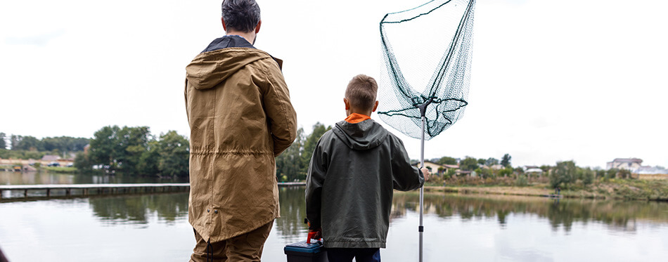 father and son are fishing