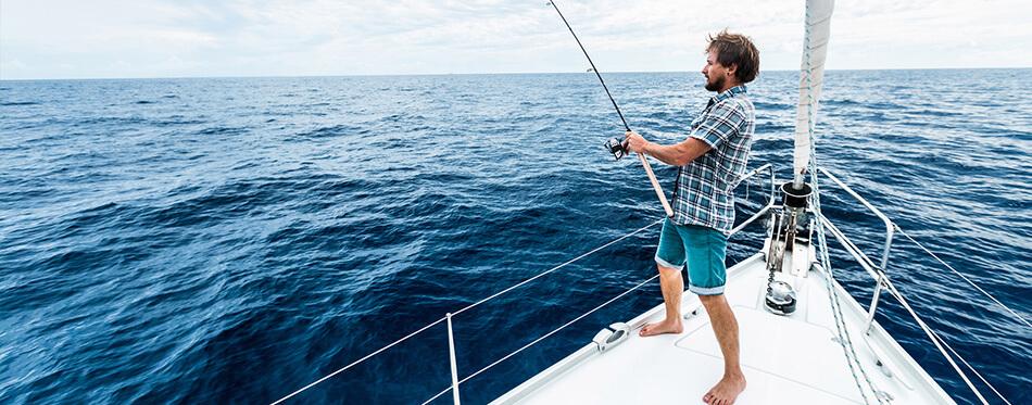 man fishing on yacht