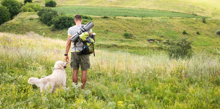a backpacker with a retriever