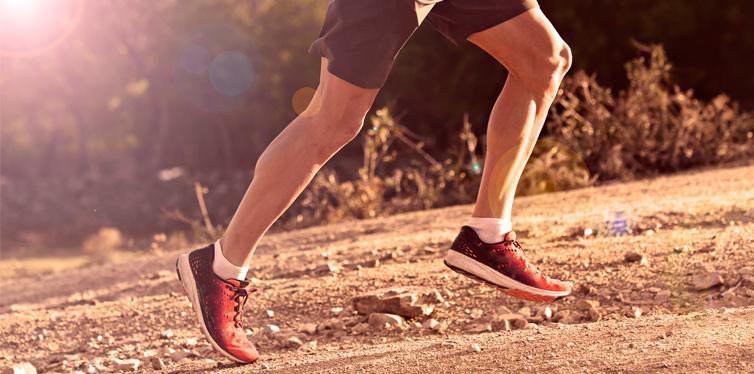 legs of a man running uphill