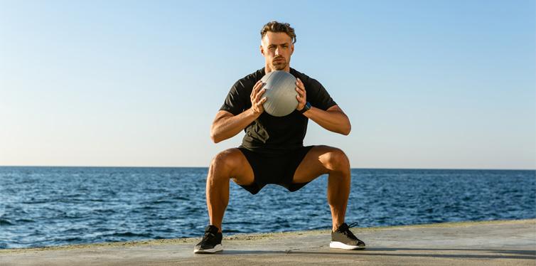 man doing goblet squats