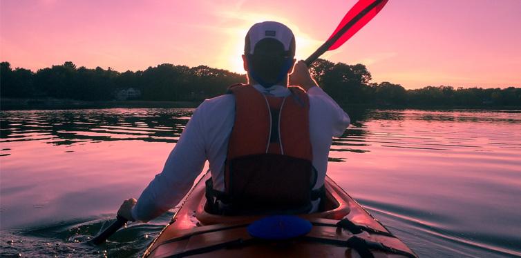 man in kayak boat