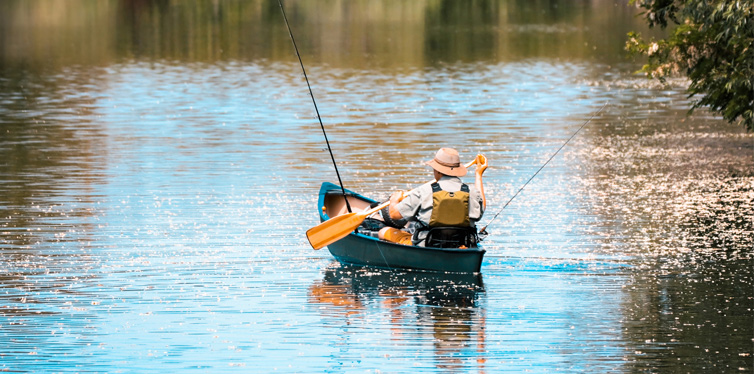 person in a boat fishing