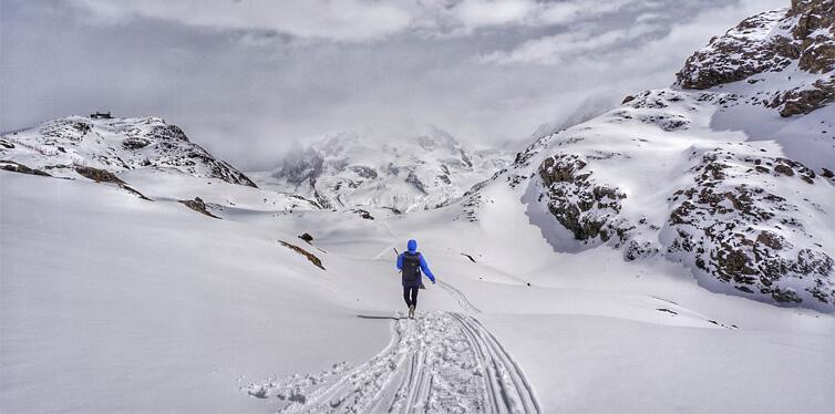 hiker in snowy mountain