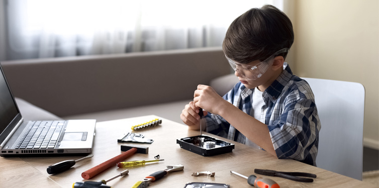 kid fixing a computer