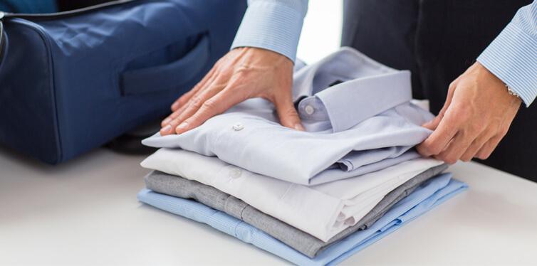 man packing shirts
