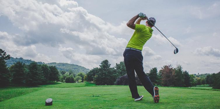 man swinging the golf ball