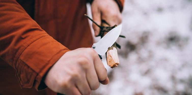 man using sharp knife