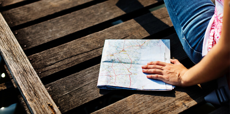 person on holiday with a map
