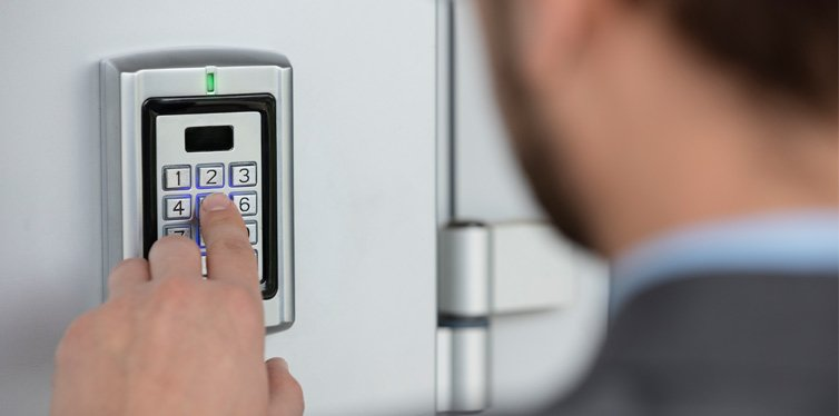 person setting an alarm system