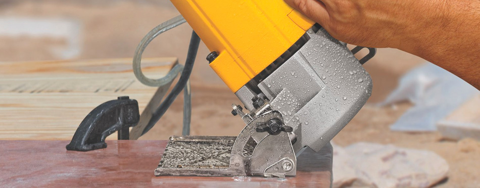 a person using a tile saw
