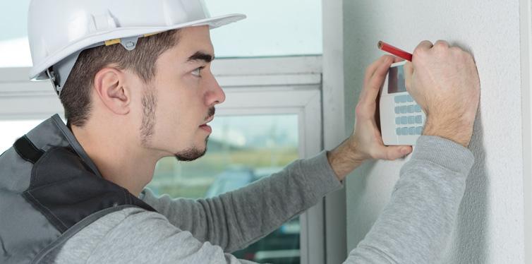 worker installing alarm