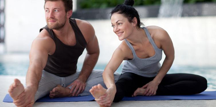 a couple doing yoga