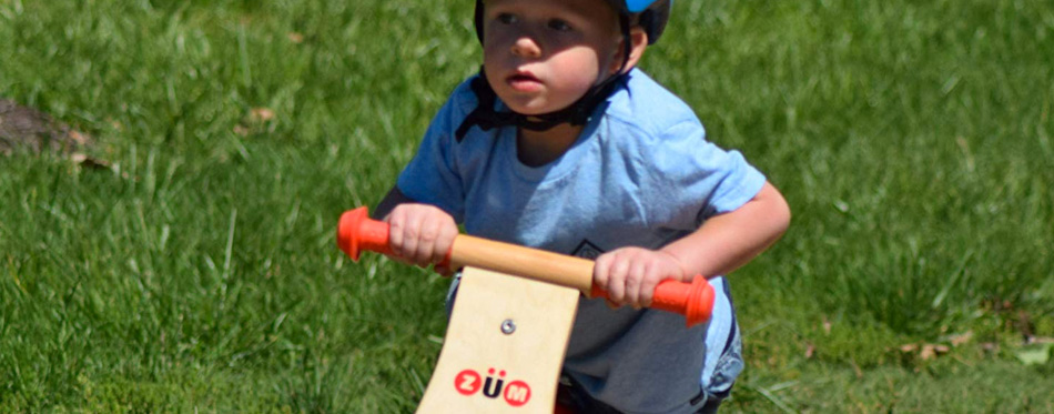 a small boy on a balance bike