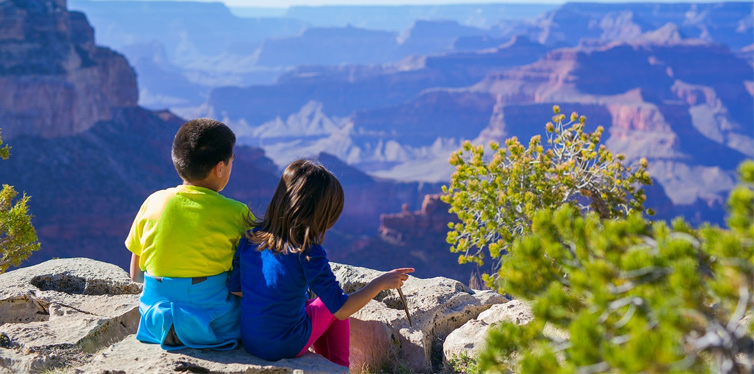 boy and girl on a rock