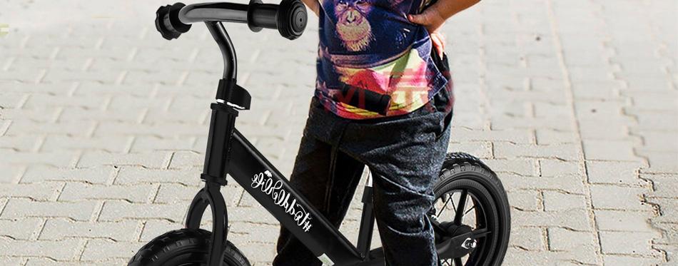 a boy riding a balance bike
