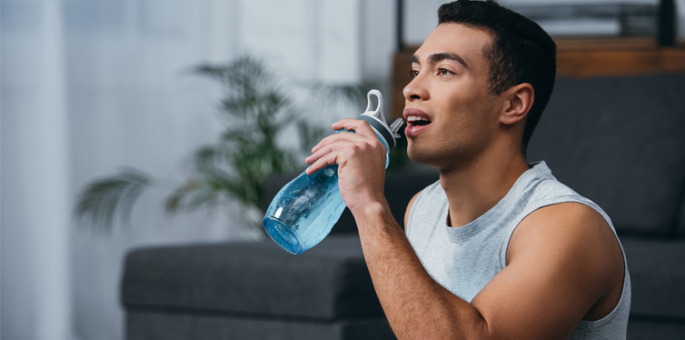 man drinking water from the bottle