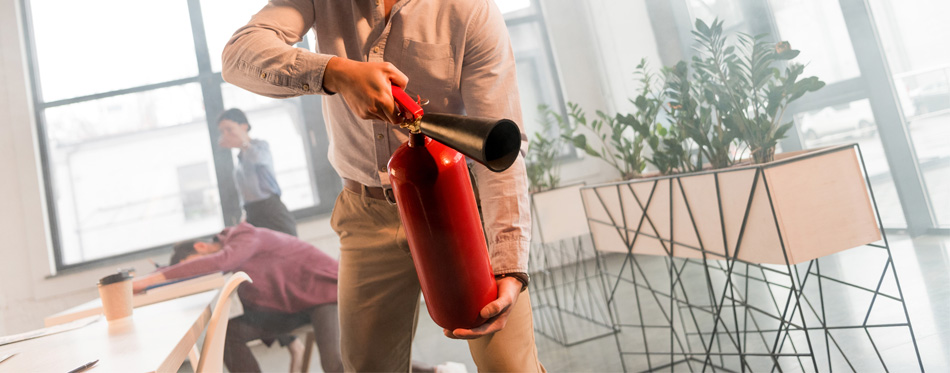 man using a fire extinguisher