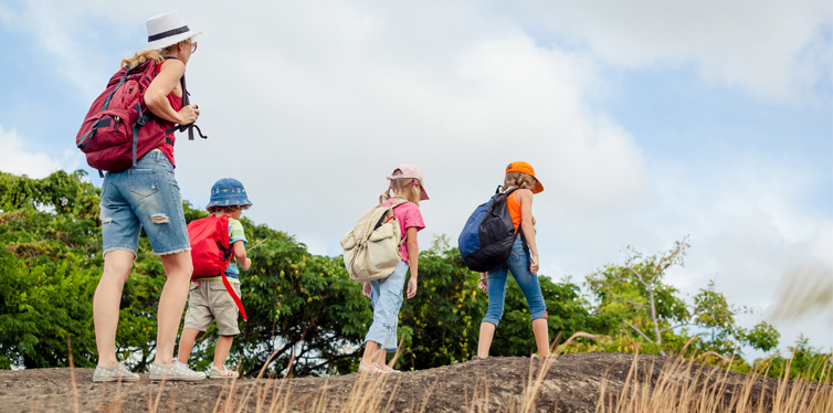 mom and kids hiking