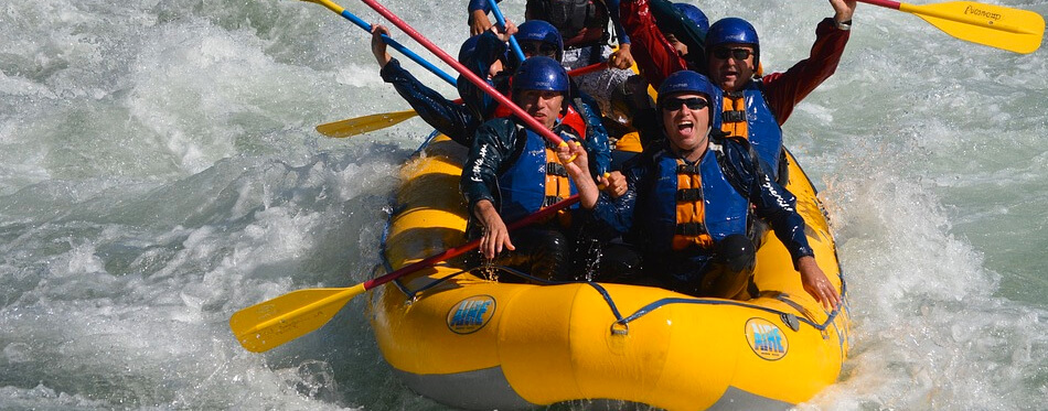 people rafting in an inflatable boat